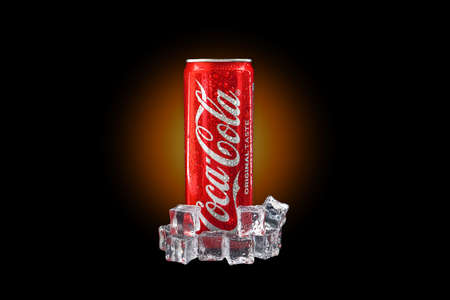 Kuala Lumpur, Malaysia - October 19, 2020 : Coca Cola or Coke Drink on yellow gradient light and black background