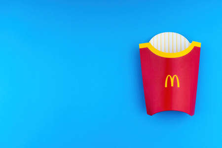 Kuala Lumpur, Malaysia - October 19, 2020 : McDonalds French fries in the French fries box on red background