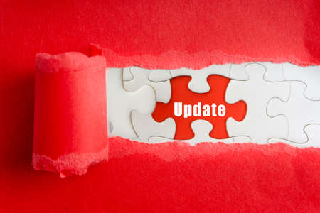 UPDATE text on jigsaw puzzle and torn paper. Selective focus Stok Fotoğraf