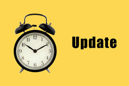 UPDATE text with alarm clock on yellow background. Business Concept