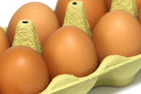 Fresh eggs in a carton, close-up. photo