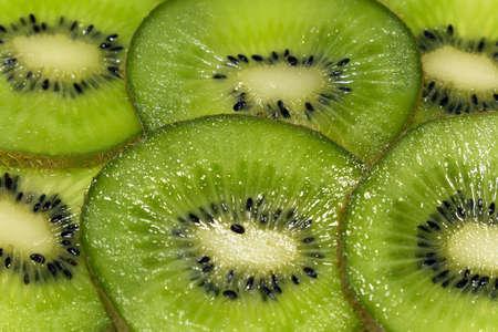 healthful: Juicy slices of kiwi fruit up close. Stock Photo