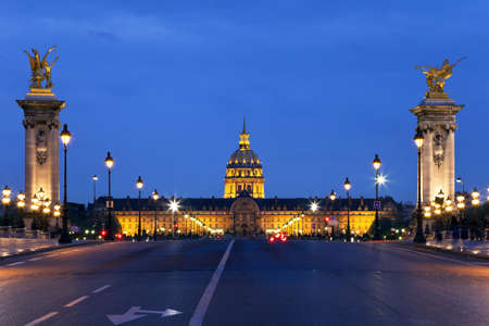 The Alexander III bridge and the dome of Invalides at night. Paris, France