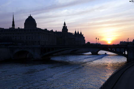 River Seine, Conciergerie Castle and Palace of Justice at sunset. Paris. France.