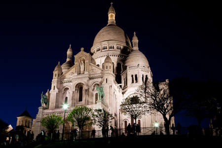 Basilica of Sacre Coeur at night. Montmartre - one of the most famous landmarks in Paris photo