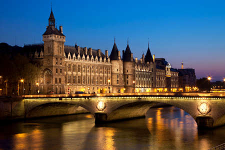 Castle of the Conciergerie and the bridge Changed at night. Paris, France.