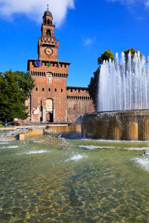 View of famous fountain and Castle tower on the Castle square. Milan, Italy Editorial