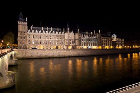 Castle Conciergerie and Seine river at night. Paris, France.
