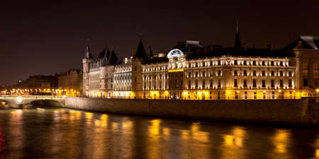 The Seine river at night - Paris, France Editorial