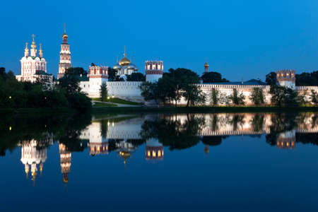 New Maidens Convent (Novodevichy Monastery). Night view  from pond, reflection in water. Moscow, Russia.