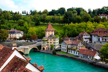Bridge over  Aare river and colorful town houses in Bern
