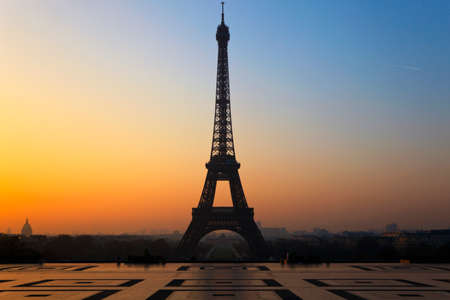 The Eiffel Tower in Paris, seen from the Trocadero at sunrise.