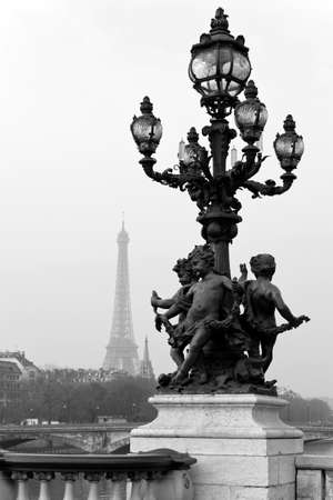 Street lantern on the Alexandre III Bridge against the Eiffel Tower in Paris, France. photo