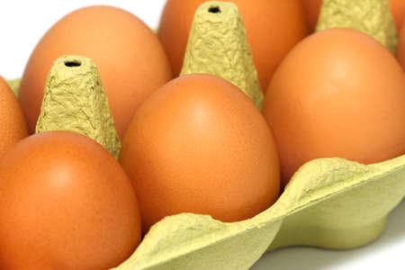 Fresh eggs in a carton, close-up. Stock Photo