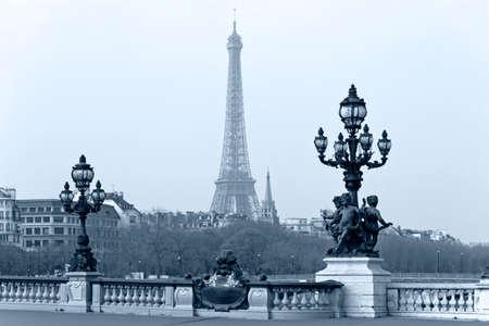 Street lantern on the Alexandre III Bridge against the Eiffel Tower in Paris, France. Stock Photo - 22421998
