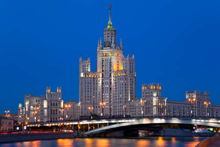 High-rise building on Kotelnicheskaya embankment in Moscow at night, Russia.