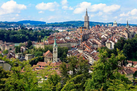 Bern, the capital of Switzerland. Beautiful old town. Prominent cathedral tower. Stock Photo