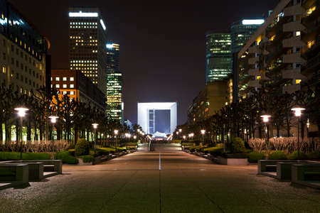 fense: Perspective a night view of the Grand arch in the financial and business district of Paris - La Défense. Stock Photo