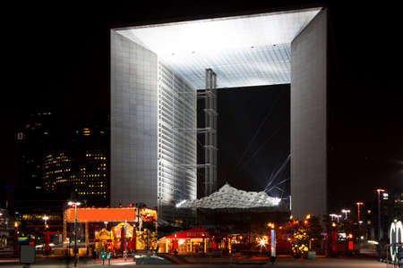 Night view of the Grand arch in the financial and business district of Paris - La Défense.