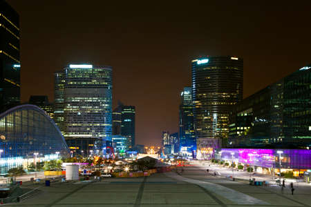 Perspective a night view of financial and business district of Paris - La Défense.