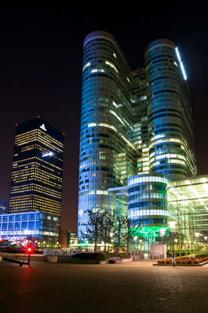 Skyscraper at night financial business district of Paris - La Défense. Stock Photo