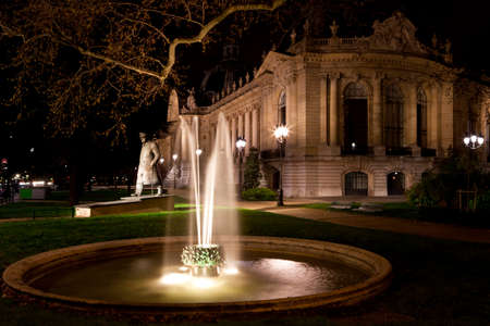 The fountain and statue of Winston Churchill near the Petit Palais in Paris at night. France.
