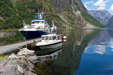 Ship and boat moored at Sognefjord, Norway.