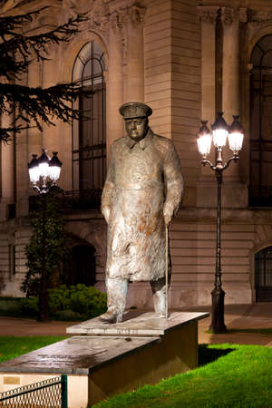 Statue of Winston Churchill near the Petit Palais in Paris at night. France.