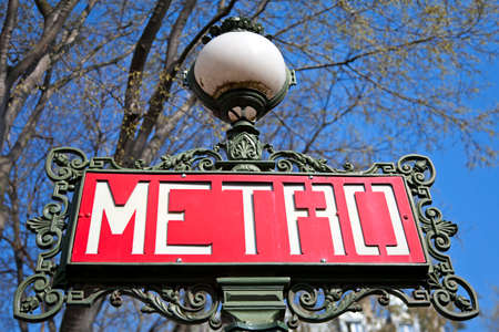 Paris metro sign with trees and sky background. Stock Photo