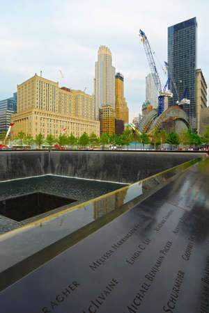 NEW YORK, NY - MAY 21, 2014: Memorial Park, in New York City, consists of two pools with 30 ft waterfalls. Victims names are inscribed in the bronze parapets surrounding the pools.