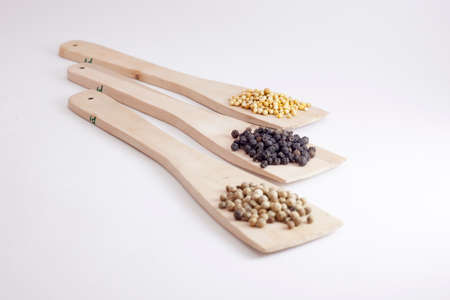Mix spices on a wooden spatula