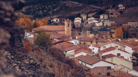 View of a traditional spanish mountain village from behind a cliff.