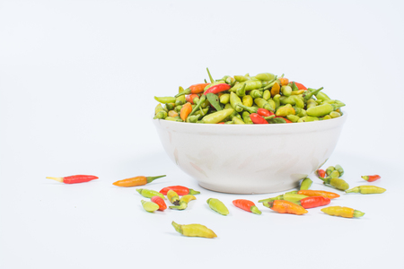 Red and Green chili or Thai chili is a chili pepper on white background Stock Photo
