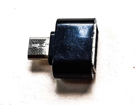 C type O T G connector is on a white background and it is black in color. Banco de Imagens