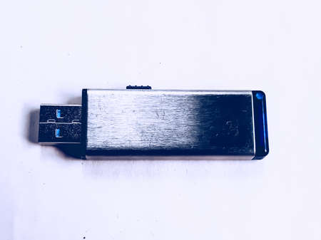 A black pen drive is placed on a white background. it is very good and has a capacity of 64 GB.