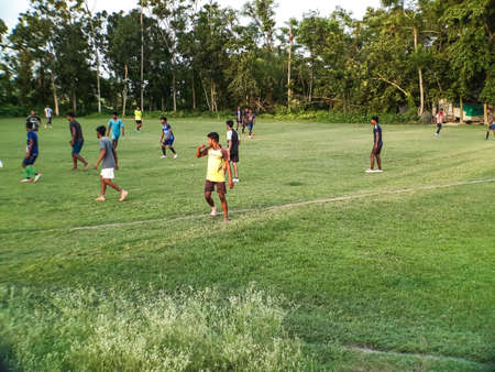 Foot balls are played in june at a playground in the village of Bridhapalla in the Indian state of West Bengal.
