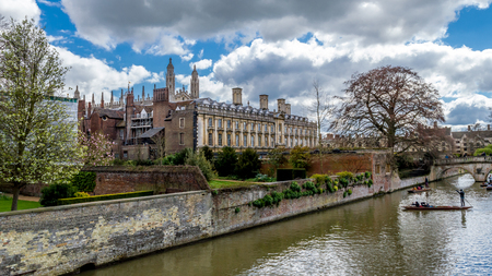 Cambridge, United Kingdom - Apr 17, 2016 : People punting on the river Cam with Clare College and Clare Bridge in background Editorial