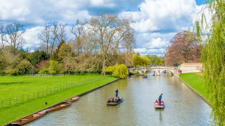 Cambridge, United Kingdom - June 17: People punting on river Cam on a bright sunny summer weekend, Cambridge