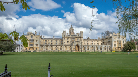 Cambridge, United Kingdom - 17 June, 2016 : Saint John College on a bright sunny day with patches of clouds over the blue sky, Cambridge