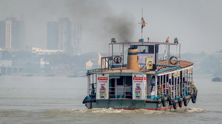 Kolkata, India - 4 March 2018:  An isolated view of a ferry crossing river Ganges or Ganga with commuters from the city of Kolkata to Howrah, Kolkata, West Bengal, India