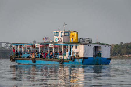 Kolkata, India - 4 March 2018:  An isolated view of a ferry crossing river Ganges or Ganga with commuters from Belur Math to Dakhineswar Temple, Kolkata, West Bengal, India Editorial