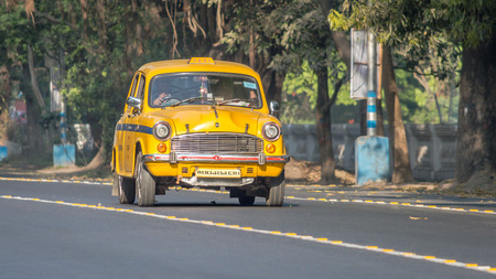 Kolkata, India - March 11th 2018: Iconic yellow Indian taxi in Calcutta (Kolkata) India. The Ambassador taxi is no more built by Hindustan Motors but thousands still remain on the streets of many Indian cities