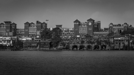 KOLKATA, INDIA - NOVEMBER 4, 2018: A black and White view of Howrah Station as viewed from Mallick Ghat. Howrah railway station is a historic colonial structure. Editorial
