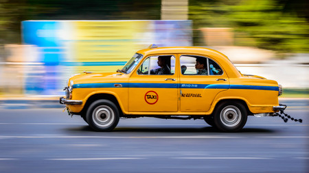 Kolkata, India - November 18th 2018: Iconic yellow taxi at Calcutta ( Kolkata ) India. The Ambassador taxi is no more built by Hindustan Motors but thousands still remain on the streets of India
