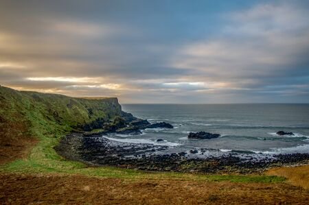 Northern Ireland Antrim Coast Ballintoy Harbour with rocks and sunset waves, beautiful scenery