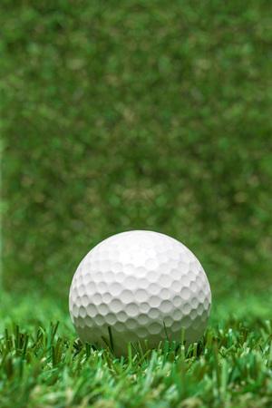 golfball: golfball recumbent on grass