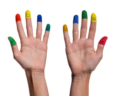 smileys: painted fingertips with smileys Stock Photo