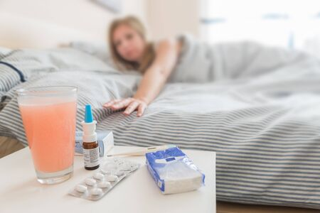 handkerchiefs: Young, sick woman is lying in bed for recovery with medicine during sleep