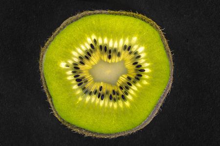 actinidia deliciosa: Detail of kiwifruit as half