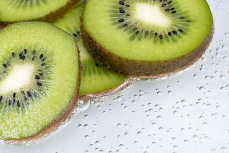 actinidia deliciosa: Slices of kiwifruit as macro